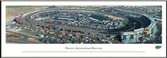 NASCAR Tracks - Phoenix International Raceway Aerial - Framed Poster Print by Laminated Visuals. $89.95. This aerial panorama of Phoenix International Raceway, a one-mile oval track, was taken during a NASCAR Nextel Cup race. Carved out of the foothills of the Estrella Mountains, Phoenix International Raceway opened in 1964 and is home to two NASCAR Nextel Cup events as well as the Grand American Road Racing Series. The NASCAR Nextel Cup Series race came to the Phoenix Internat...