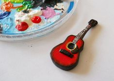 Great tutorial for guitar carved out from a block of polymer clay (Fimo Effects) | Source: Breslog