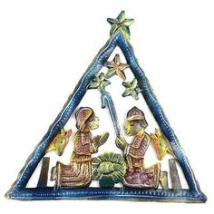 Painted Triangle Nativity Wall Art - Croix des Bouquets (H) Hand-cut and embossed from steel drums by Haitian artisans, this hand-painted nativity features a triangle design. It measures 8 inches tall by 7 inches wide. Outdoor Metal Wall Art, Metal Art, Drums Art, Steel Drum, Nativity Crafts, Nativity Sets, Handmade Christmas Decorations, Triangle Design, Christmas Store
