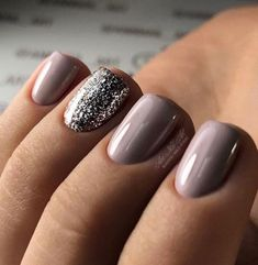 Beautiful manicure with a purple-based mauve-gray color, and a sparkly silver accent nail. Perfect for the holidays.