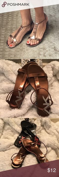 Bronze Anne Klein Sandals Gorgeous and comfy sandals by Anne Klein. They feature a comfy strap along the back of the heel and a beautiful bronze color that compliments your outfits! Shows some signs of wear.  Anne Klein Shoes Sandals
