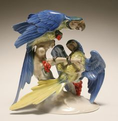 Large Hutschenreuther porcelain figure of two brightly colored parrots.