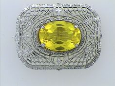 Sterling Silver Filigree Brooch with Yellow Stone