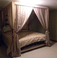 *hubby homemade canopy bed* ~ Now all that's left is to brand the wood