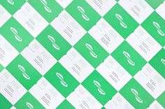 Logo and business card with fluorescent green paper and white ink combination designed by Lundgren+Lindqvist for Swedish print production an...