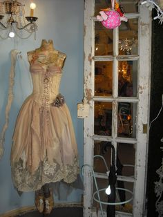 antique dress form....love it except for the weird pink flying thing in the top of the photo. lol