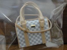 "unknown artist - ""designer"" handbag with beige leather strap; sold on ebay for $15.51"