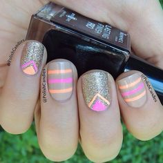 nude nails with gold glitter and neon stripe..