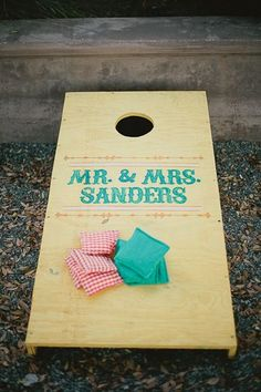 I like this one better, but the two separate ones allow two people to play together at the same time! adorable cornhole board