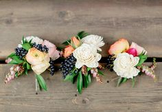 rustic boutonnieres | Laura Murray Photography | Blog.theknot.com