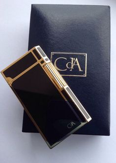 100 % AUTHENTIC CARAN dACHE LIGHTER ~ CHINA LACQUER BLACK WITH 18 K GOLD PLATE TRIM SWISS MADE AND HALLMARKED-PEDIGREE NUMBERED. CARAN