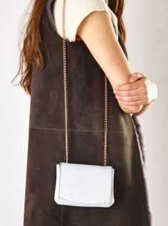 Young+British+Designers:+Leather+Micro+Bag+in+Pale+Grey+by+Baia+Bags+-+We+love+the+shape+this+bag+makes+when+you+wear+it+cross+body+style.+The+softest+pale+grey+leather+complements+the+rose+gold+chain+beautifully.