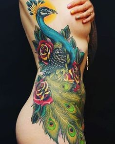 Sexy feminine peacock tattoo on the side