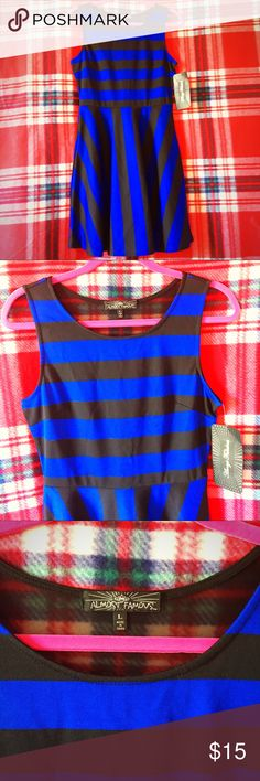 Almost Famous Striped Flare Dress Blue and Black Striped Flare Bottom Dress by Almost Famous. Brand New With Tags. Sheer Triangular Design on back. Sleeveless. Stretch Material. 96% Polyester 4% Spandex. Almost Famous Dresses Midi
