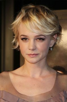 Carey Mulligan. I need to look into wavy hair styles while here in Ireland. My natural curl will NOT stay straight.