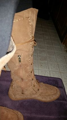 Super cute Ugg Moccasin tie-up boots.