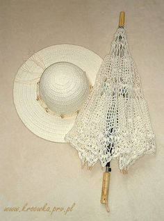 15 #Crochet Umbrellas and Parasols to Block that Summer Sun. This ecru-colored crochet umbrella sold by Etsy's kroowka looks just as good when it's closed up as it does when it's open.