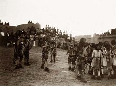 Oraibi Snake Dance. It was created in 1904 by Edward S. Curtis.    The photograph presents Hopi Indians in Arizona, in snake ceremony, with pueblo and onlookers in the background.