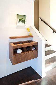 This is the ultimate catch-all spot. It has built-in chargers (something to consider) and a minimalist, contemporary look. Most of our catch-all drawers will never look this good, but we can try.