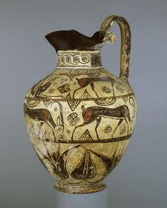 East Greek pottery oinochoe (wine-jug); shoulder: griffin between two goats; belly: four goats with a water-bird beneath the handle; the neck has a cable pattern, and around the bottom is a pattern of lotus buds and flowers; Middle Wild Goat style    Greece (Rhodes)   Date 630-600 BC