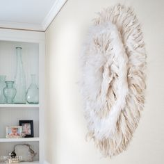 Simple directions for making this absolutely gorgeous DIY juju hat feather wall hanging. It's a stunning statement piece and so easy to make!