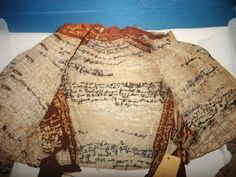 Another view of Agnes Richter's autobiographical jacket. A patient in a mental asylum, she embroidered her jacket with messages that were undecipherable. Now the property of a museum. Outsider Art at its best.
