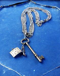 Multi strand silver vintage key and watch by DejaVuVintageJewelry