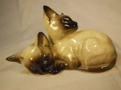 Two Cute Siamese Kittens curled up and snuggling together. The Kittens were made by Beswick England and have the brightest blue eyes! by VintageQualityFinds on Etsy