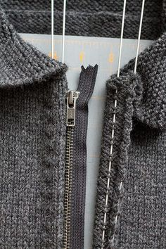 Use Blocking wires to sew a zipper into a knitted item. Simple and holds knitted edge in place. No stretching or puckering.
