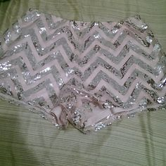 NWOT Charlotte Russe pink + silver sequin shorts Never worn only tried on once. Labeled large can fit a medium. Shorts are lined with light pink Chiffon like material. Just beautiful Charlotte Russe Shorts