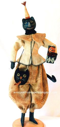 Another kitty created by me, dressed in finery using new and vintage fabrics. His goodies are also made by me. He is a lot of  fun.