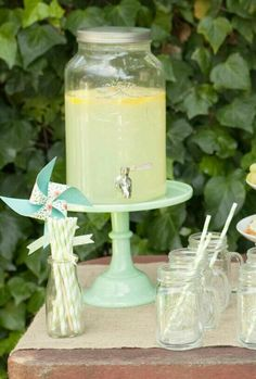Use a cake stand to boost a beverage dispenser.