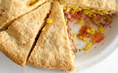 tomato-and-corn pie. flour, baking powder, salt, butter, milk, tomatoes, mayo, lemon juice, corn, basil, chives, pepper, and cheddar.