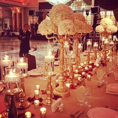 Hydrangeas and Babys breathe center pieces with this exact gold candelabra... perfect!!