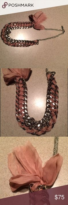 """Adia Kibur Silver Chain Pink Chiffon Necklace ADIA KIBUR Large chain looped with chiffon and a beautiful chiffon bow detail.   Color: Pink Measurement: Length 26"""", Width 1.25"""" Adia Kibur Jewelry Necklaces"""