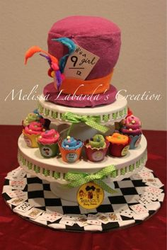 Mad hatter diaper cake alice in wonderland theme my diaper cakes mad hatter diaper cake with tiers of alice in wonderland themed washcloth cupcakes originally designed and created by melissa l publicscrutiny Image collections