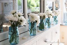 Decorating with blue mason jars and flowers. And a bit of nautical, beach, coastal decor too. http:www.songbirdblog.om