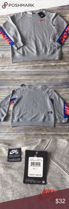 NWT Nike SB Sweatshirt NWT Nike SB gray heathered sweatshirt with royal blue and orange detail in boys size large (12-13 years).  Nike SB (skateboarding) print on underside of sleeves and stitched on right chest.  Pet/smoke free home. Nike Shirts & Tops Sweatshirts & Hoodies