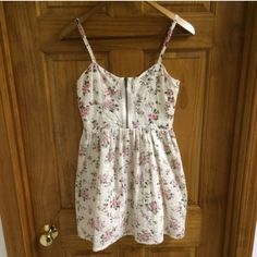 Top Shop Dress Top Shop Dress Size 4! White and Pink Floral! New and Never Worn! Zipper in Front and Back with Adjustable Straps! Perfect for Spring! Topshop Dresses Mini