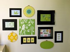 Fun decor with old frames, embroidery hoops, & scrapbook paper.