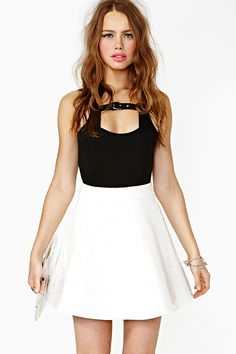 This skirt I freaking love. I would wear it just like u see it here but with a white top and make it look like a dress with a wait belt. and some cute colorful shoes