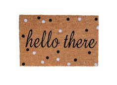 Polka dots make for a playful greeting with our Hello There Doormat.