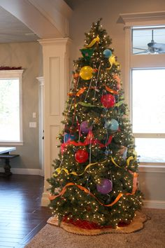 A New Year's tree! Take off the Christmas decorations and add balloons, noisemakers, etc..on NYE take off the decorations to have a ready-made party! Fun for the kids :)
