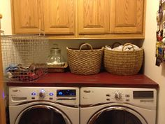 This is pretty too - love the cabinet and red counter for the laundry room
