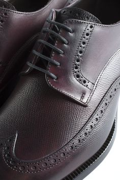 This dynamic pair of dress shoes blends the elegant contours of a derby with the vibrant texture of a brogue. Made from vegetable-tanned Italian calf leather, these dark brown lace-ups are made with a Blake stitch construction. Brown Derby, Contours, Spring Summer 2015, Brogues, Calf Leather, All Black Sneakers, Dark Brown, Calves, Vibrant