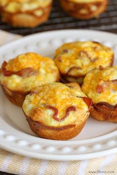 Simple Cheesy Breakfast Bites - a crescent roll bottom with eggs, bacon and cheese on top!