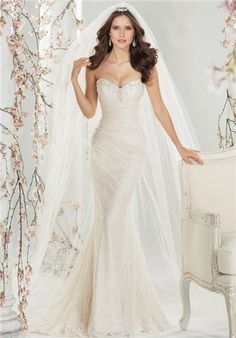 Silhouette: A-Line Neckline: Sweetheart Waist: Empire Gown Length: Floor Train Style: Attached Train Length: Sweep Sleeve Style: Strapless Fabric: Lace Special Features: Corset Color: Ivory/Blush Size: 0 - 22 Price: $$
