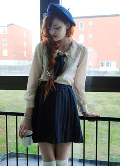 Pretty pleats and buttoned blouses