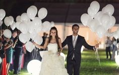 Ooooh... white balloons with white glow sticks inside... What a neat send off idea.
