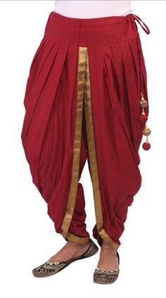 Best 12 Black cotton dhoti pant detailed with foil printed waist band in geometrical motif Enhance with pleats and contrast piping – SkillOfKing. Salwar Suit Neck Designs, Kurta Neck Design, Salwar Designs, Kurta Designs Women, Kurti Designs Party Wear, Blouse Designs, Dhoti Salwar Suits, Salwar Pants, Designer Salwar Suits